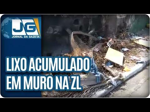 Morador reclama de lixo acumulado em muro de escola na Zona Leste
