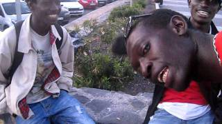 "Crazy girl teaching Senegal boys norwegian version of ""Whazzup?"""