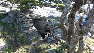 PRIMITIVE STONE SHELTER BUIĻDING AND COOKING OVER THE FIRE TURKEY ON A STICK (PANORAMIC VIEW)