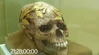0121 Skull of a gold wreathed victorious ancient games athlete & coin for Charon