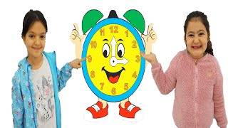 Masal and Öykü Learn How to Tell Time on A Clock | Learn and Play Video for Kids