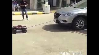 Real car pulled by a small remote car - Amazing !