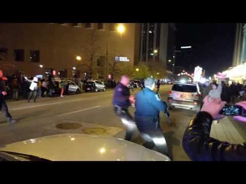 Indianapolis Trump protests: Police on horseback ride through line of protestors in the street