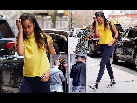 Malia Obama heads to work in a yellow tank top a day after Secret Service.