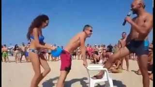 Funny & Crazy ballon game by players on beach