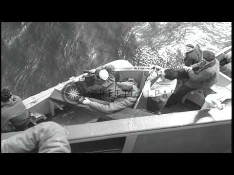 USS Larson fires at Japanese submarine I-402 which sinks. HD Stock Footage