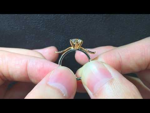 Solitaire Diamond Engagement Ring With Custom Rose Gold Wing Design