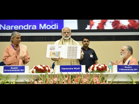 PM Modi releasing Special Commemorative Postage Stamp on 100 years of Yogoda Satsang Math