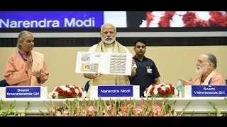 PM Modi releasing Special Commemorative Postage Stamp on 100 years of Yogoda Satsang Math   PMO