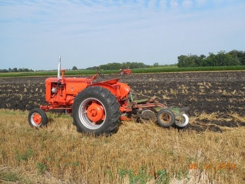 1952 CASE VAC 13 Pulling a CASE 2-14's mounted plow.