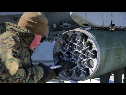 Marines Loading Some Serious Firepowers Onto AH-1Z Attack Helicopter