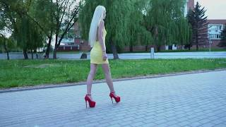 confident-walk-in-park-and-high-heels