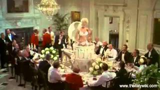 Virna Lisi - emerges from the cake