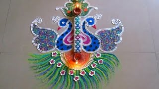 Beautiful and unique twin peacock rangoli | Innovative rangoli designs by Poonam Borkar