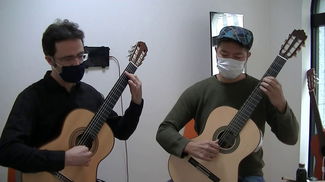 "Hiroshi & Carl play ""Invention No. 2"" by J. S. Bach"