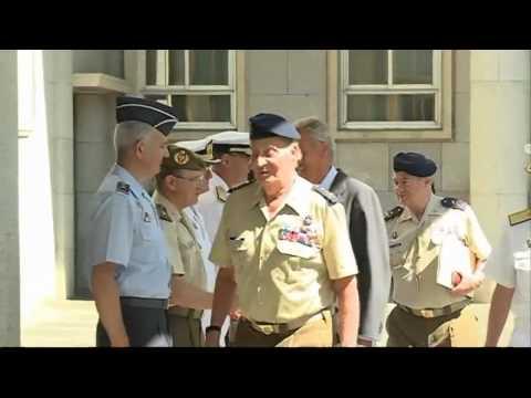 King Juan Carlos of Spain trips over at military meeting