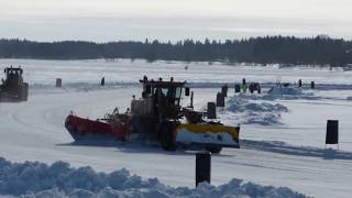 CAT Motorgrader and Volvo,Lundberg Wheel Loaders Plowing a Iceracing track