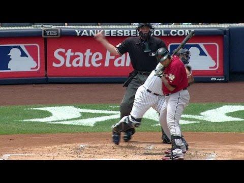Posada's throw to third hits Lee's bat