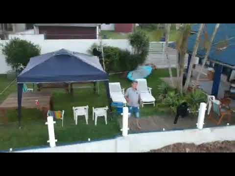 Tio e filmagem de drone, no Rio Mampituba