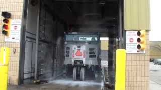 Automatic vehicle wash cleans refuse trucks, dump trucks & police cars
