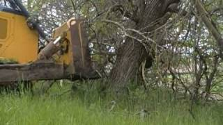 Repeat youtube video John Deere 850J pushing trees