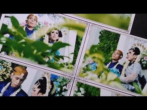 Memasang Foto Dalam Album Magnetik