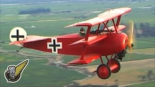 Air-to-air video of a Fokker Dr.1 Triplane, in the colours of Baron...