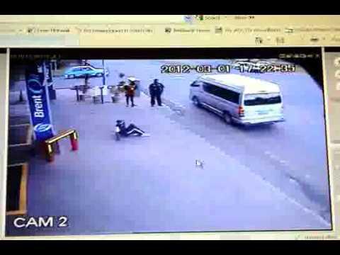 Taxi Driver runs over pedestrian..What a guy  - Bloemfontein.wmv