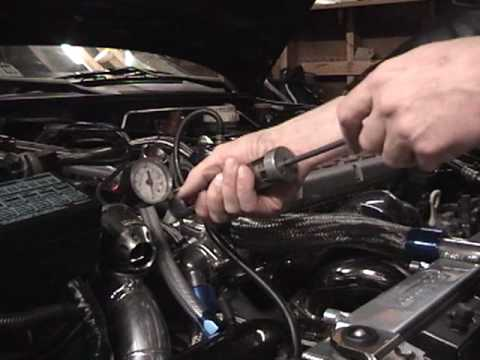 Engine coolant system and compression testing
