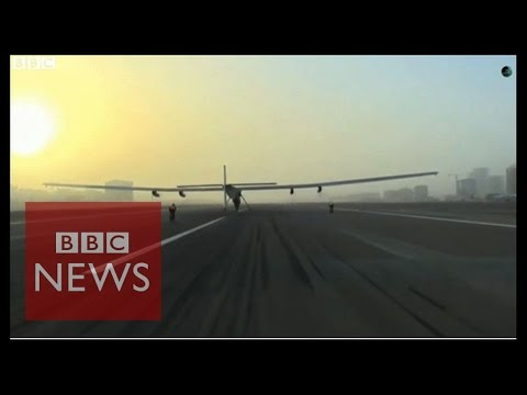 Solar plane takes off for flight around the world - BBC News