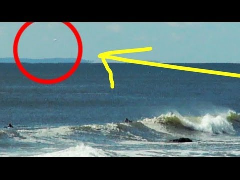 UFO Flies In The Background Of Surfers