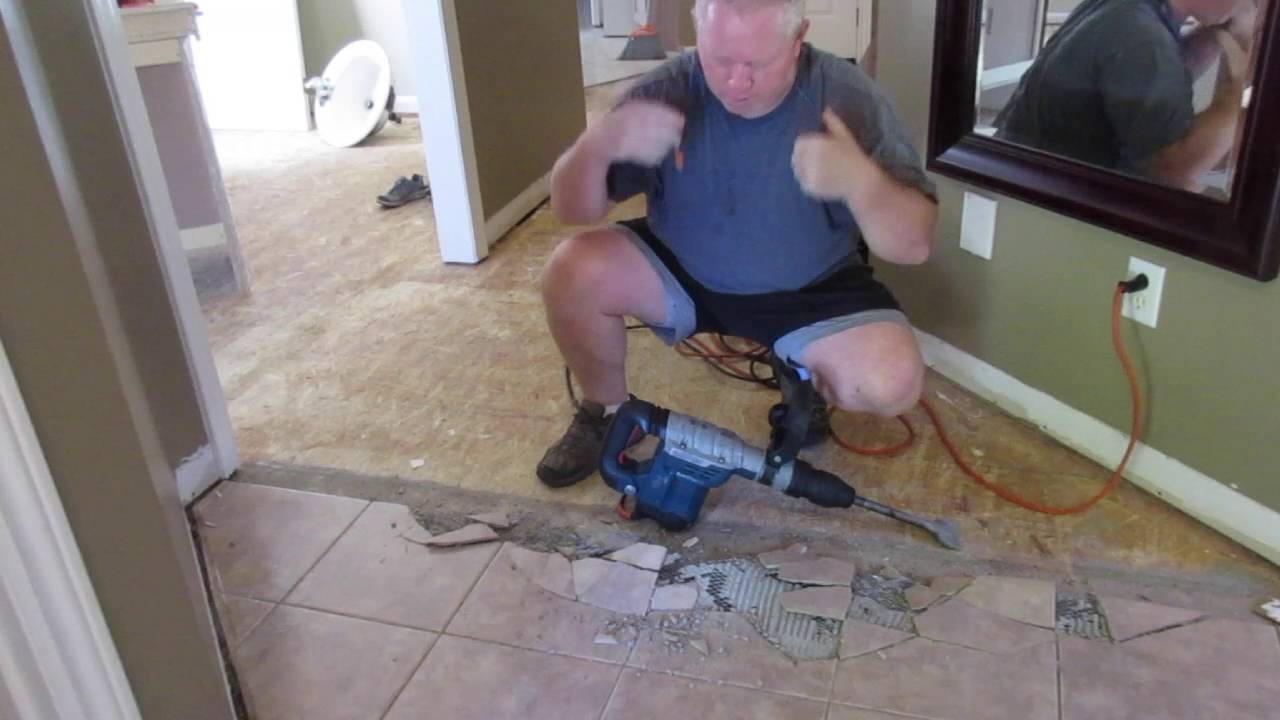 removing ceramic tiles the easy way using demolition hammer
