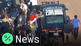 George Floyd Protests: Police Cars Swarmed On Los Angeles Freeway, U.S. Flag Burnt