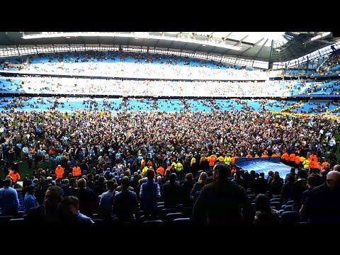 Manchester City Fans Invade Pitch To Celebrate Winning The Title