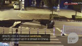 Camera captures sinkhole forming in China road – and motorcyclist checking mobile phone riding into it