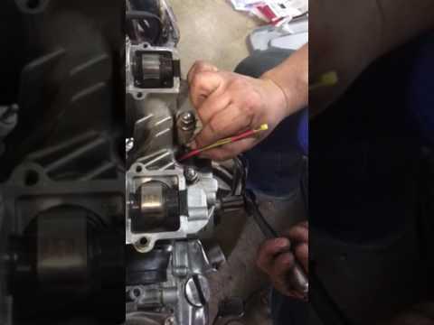 Using zip tie to change shims on Suzuki GS Motorcycles