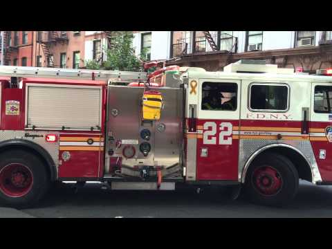 FDNY ENGINE 22 RETURNING TO QUARTERS ON E. 85TH ST. ON THE EAST SIDE OF MANHATTAN IN NEW YORK CITY.