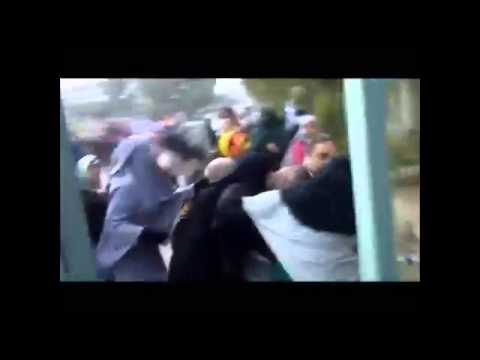 Female students fight against security guards in Cairo.