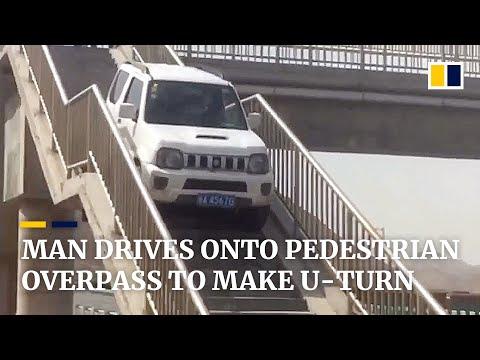 Man drives onto pedestrian overpass to make U-turn