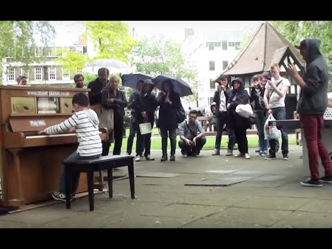 11 year old George Harliono plays Moonlight Sonata (3rd mov) on a Street Piano in the rain.