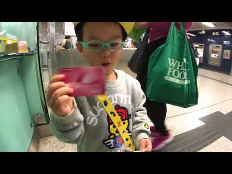 Eton buying his first ever Octopus Card at Central MTR Station