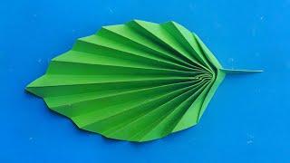 Оригами листочек цветка из бумаги. Origami Leaf Of A Flower Made Of Paper.