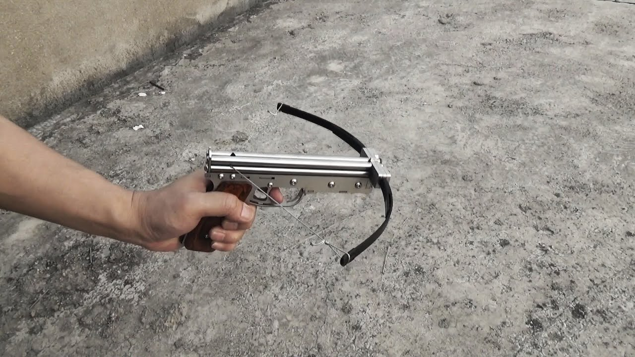 Fishing line pistol mini crossbow easy to shoot youtube for Mini crossbow fishing