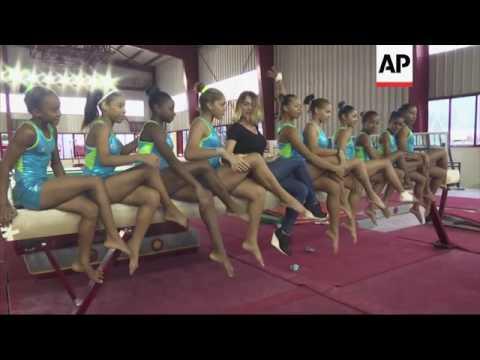 Olympic star Comaneci meets Cuban gymnasts