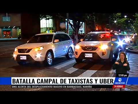Batalla campal entre taxistas y conductores de Uber en Bogotá