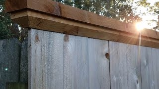 Trim Your fence with cap board..