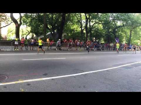 Darien runner Jennifer St. Jean crosses the finish line at the 5th Avenue Mile Sunday.