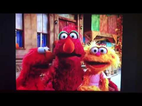 Telly, Elmo And Zoe Greeting The Viewer In A Magical Halloween Adventure