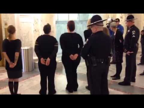 Add the Words demonstrators arrested at Idaho state Capitol