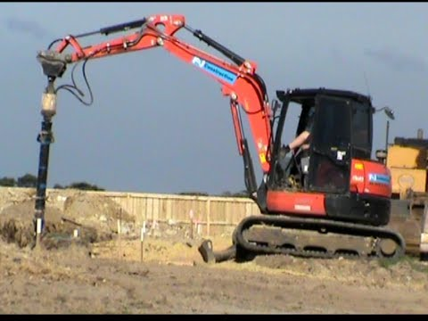 Mini excavator drilling soil.